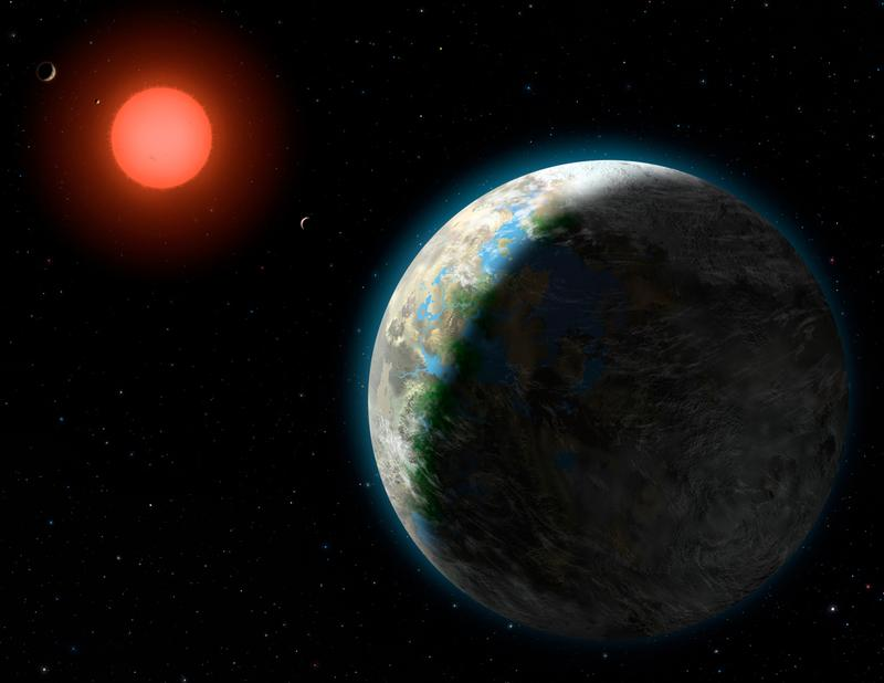 This artist's conception shows the inner four planets of the Gliese 581 system and their host star, a red dwarf star only 20 light years away from Earth.