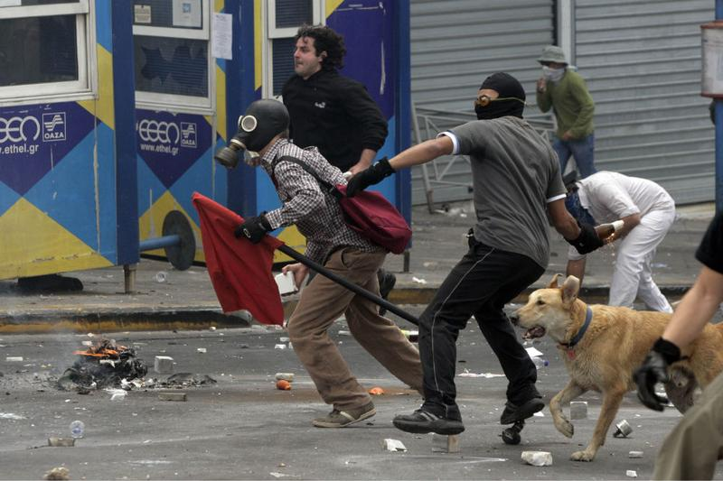 Protesters throw missles at Greek riot police as they clash on May 5, 2010 in Athens, Greece.