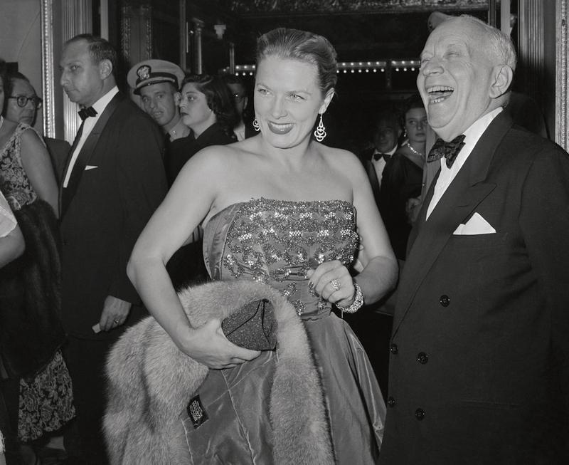 Harry Hershfield shares a laugh with the French movie star Denise Darcel, August 24, 1954.