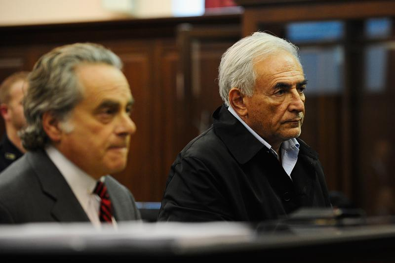 International Monetary Fund chief Dominique Strauss-Kahn (R) with his laywer Benjamin Brafman  in federal court May 16, 2011 in New York City