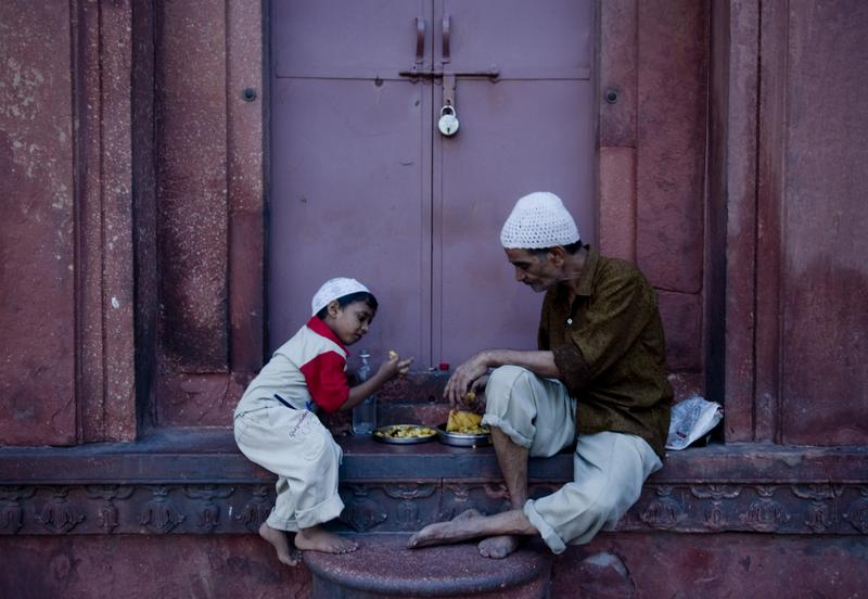 An Indian Muslim man and child break their fast on the first day of Ramadan at Jama Masjid mosque in New Delhi on August 12, 2010.