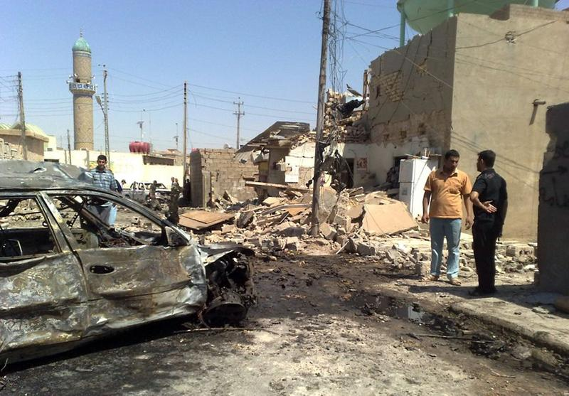 Iraqis gather at the scene of a car bomb in the western city of Ramadi, one of a series of apparently coordinated attacks across Iraq