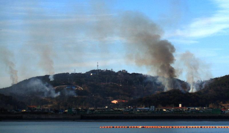 This picture taken on November 23, 2010 by a South Korean tourist shows huge plumes of smoke rising from Yeonpyeong island in the disputed waters of the Yellow Sea on November 23, 2010.