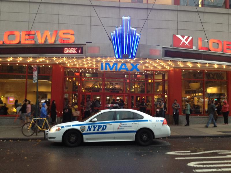 A police car is stationed outside the Lowes Theatre in Kips Bay.