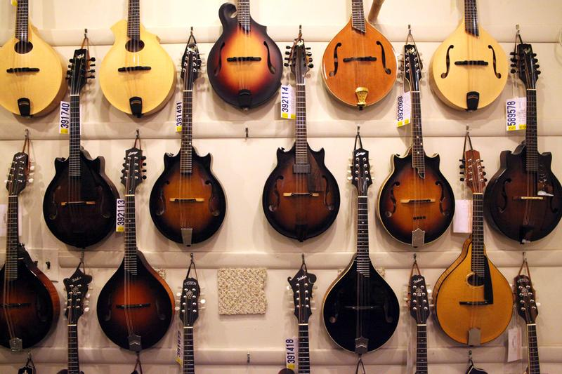 A wall of Mandolins at Mandolin Brothers. The founders chose the name because they felt the Mandolin was under-appreciated.