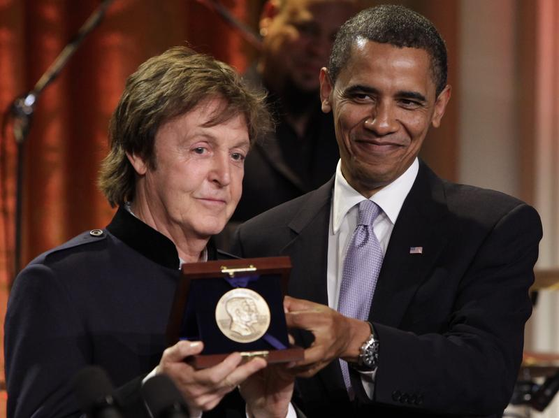 President Barack Obama presents Paul McCartney with the third Gershwin Prize for Popular Song at the White House in Washington, DC on June 2, 2010.