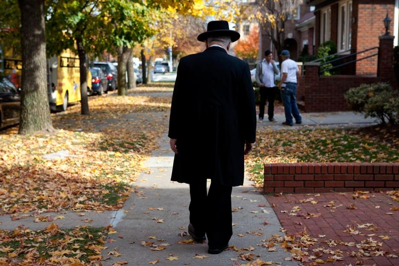 A Jewish man walks through Midwood.