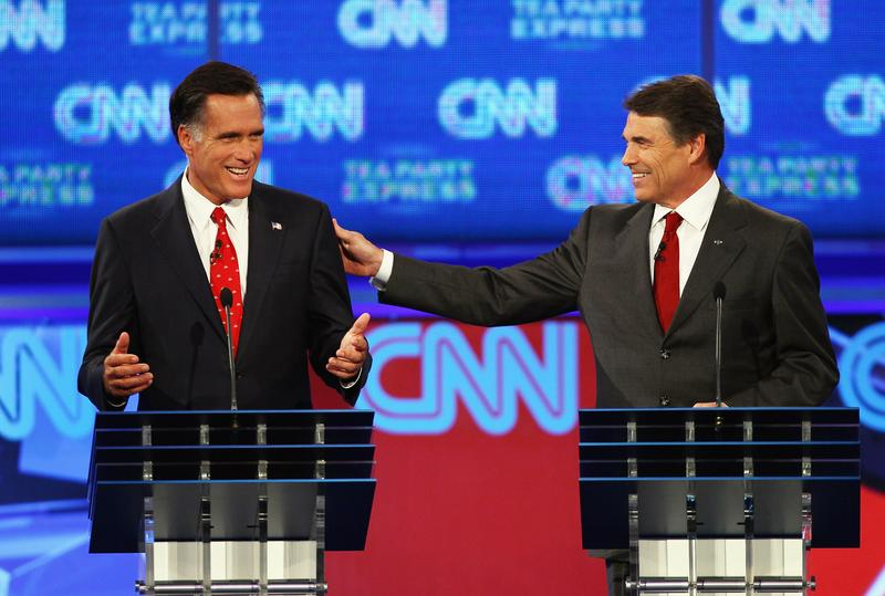 Mitt Romney and Rick Perry speak at a Republican presidential debate hosted by CNN on Monday, September 12th.