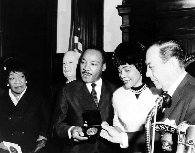 Dr. Martin Luther King Jr. recieves the city's Medallion of Honor from Mayor Wagner