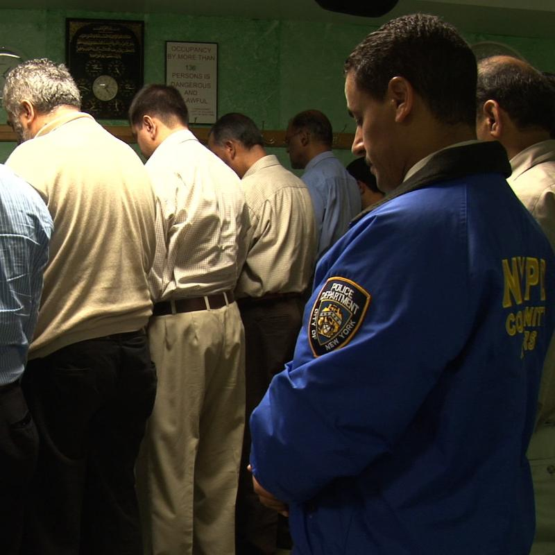 Detective Nasser, praying during a Ramadan service