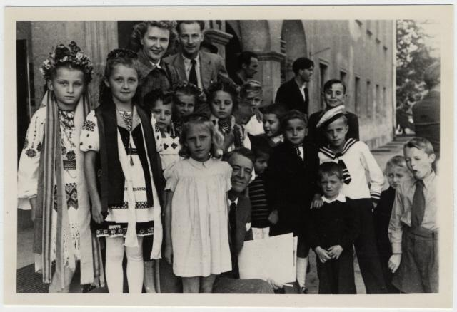Group portrait of young children, many in national garb, who await repatriation from Berlin to the U.S. zone, 1948.