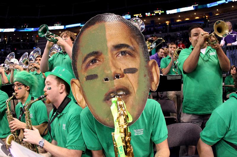 A member of the North Texas Mean Green wears a mask as they perform against the Kansas State Wildcats during the first round of the 2010 NCAA men's basketball tournament.