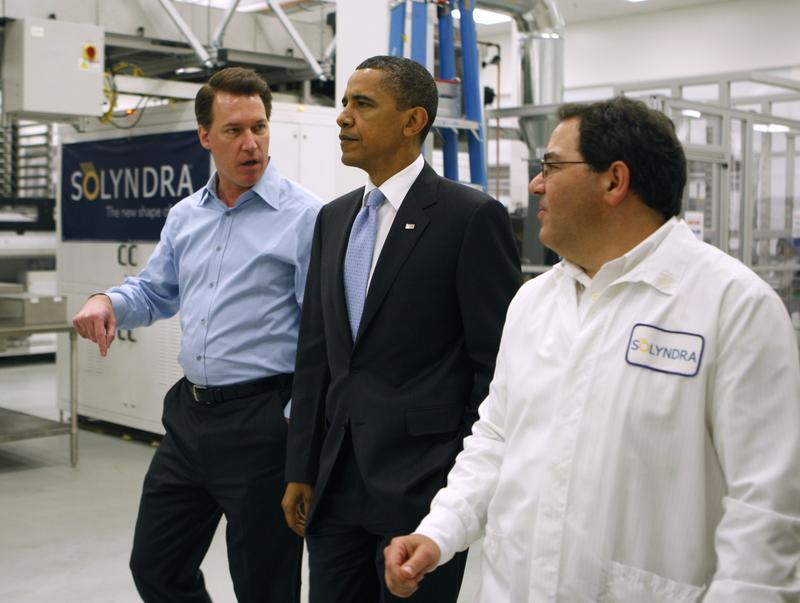 Ben Bierman (R) and Chris Gronet (L) lead U.S. President Barack Obama on a tour of the Solyndra solar panel company May 26, 2010 in Fremont, California.