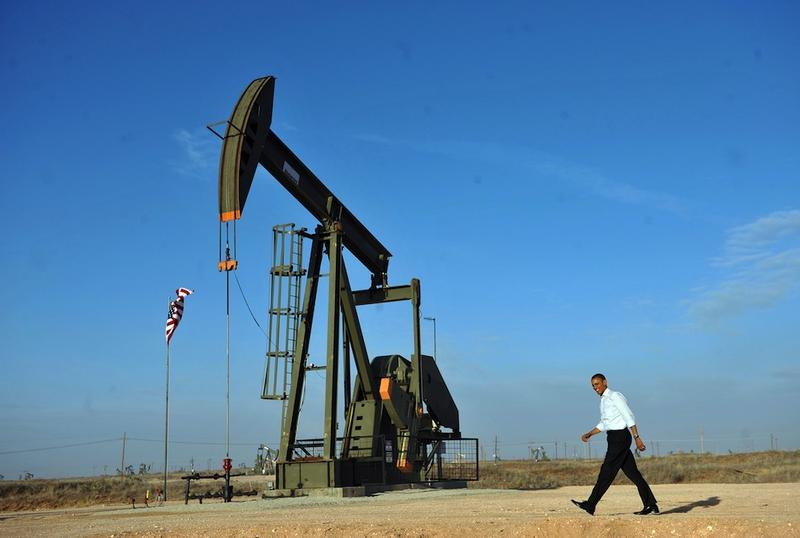Barack Obama walks past an oil rig to a stage to speaks at an oil and gas production fields on federal lands March 21, 2012 near Maljamar, NM.