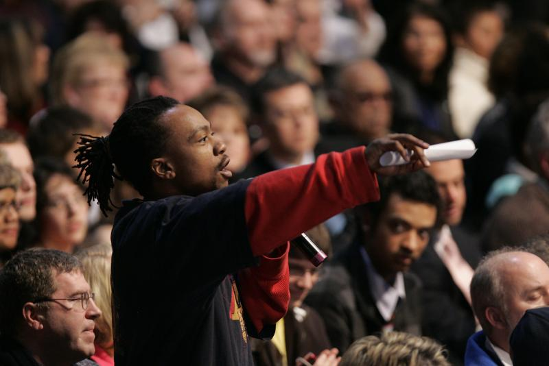 A local man stands with a question for President Obama during a town hall meeting with Ohio students, workers, local leaders and small business owners in Elyria, Ohio on January 22, 2010