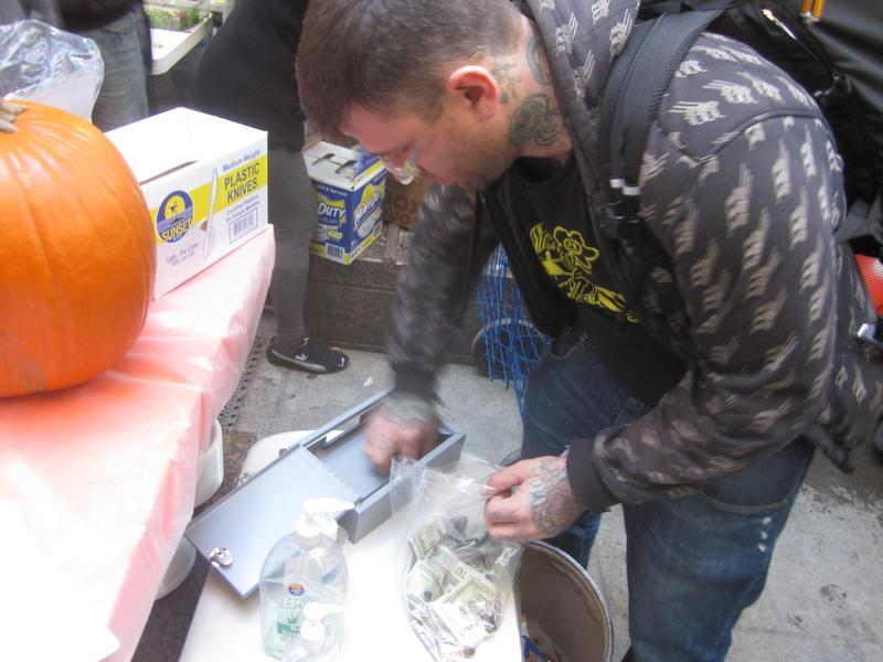 Pete Dutro collects money from the donation boxes throughout Zuccotti Park in October.