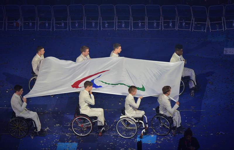 The Paralympic Flag is carried to be raised during the opening ceremony of the London 2012 Paralympic Games.