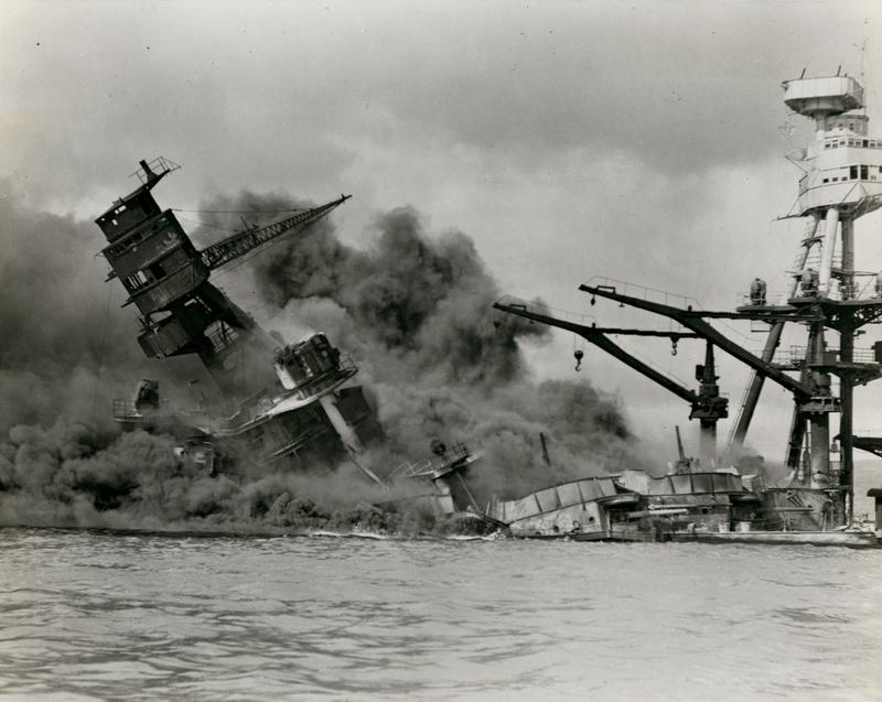 The USS Arizona sinks after sustaining damage during the Japanese attack on Pearl Harbor. December 7, 1941. Photograph by the U.S. Navy.