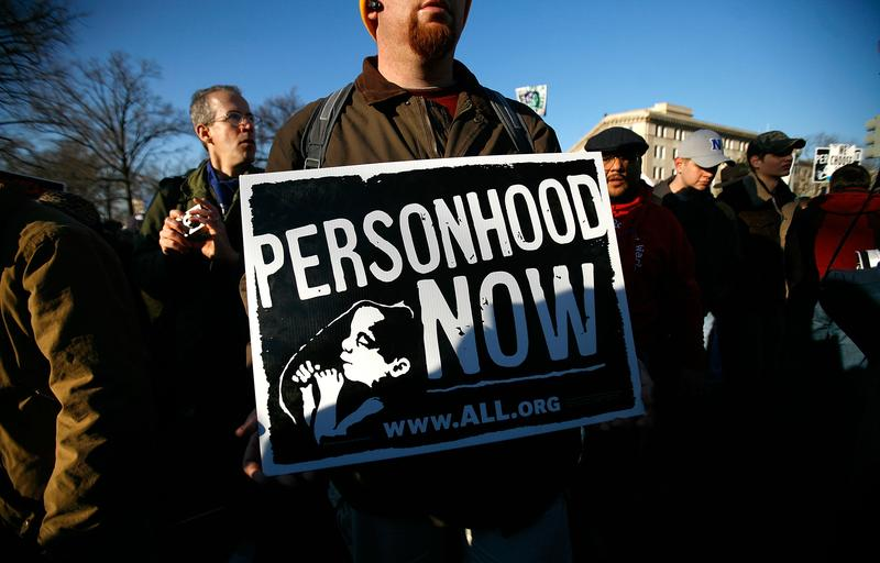 A pro-life activist holds a sign as he participates in the annual 'March for Life' event in Washington, DC.