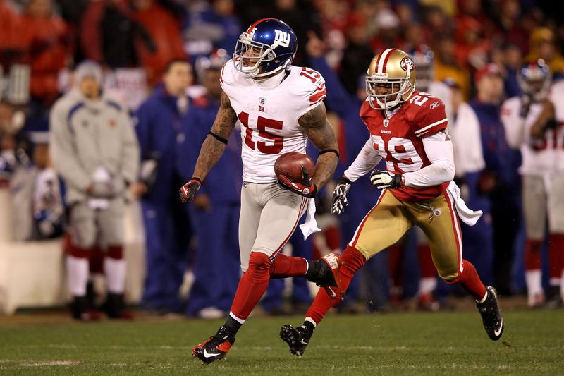 Devin Thomas #15 of the New York Giants advances the ball after he recovered on a punt touched by Chris Culliver #29 of the San Francisco 49ers.