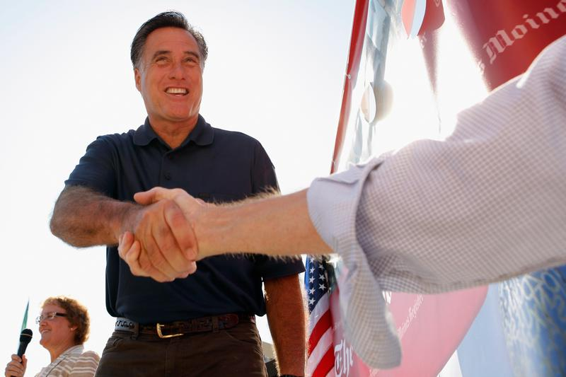 Republican presidential candidate Mitt Romney introduces himself to voters at the Iowa State Fair August 11, 2011 in Des Moines, Iowa.
