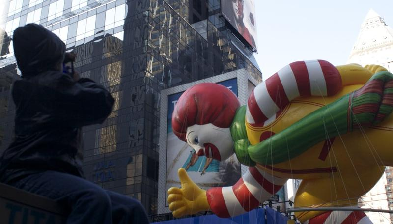 One kid gets a great view of the Ronald McDonald Balloon at Macy's Annual Thanksgiving Day parade.