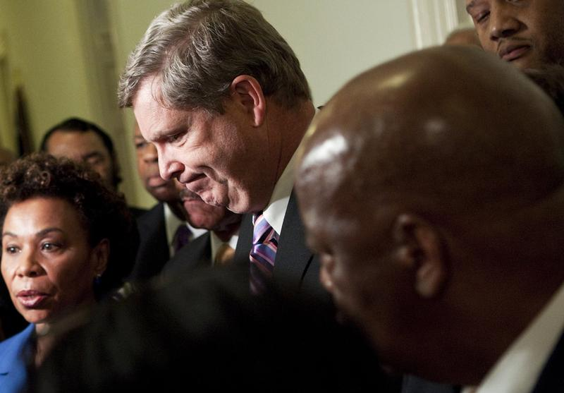 Secretary of Agriculture Tom Vilsack listens as members of the Congressional Black Caucus speak to the press after a meeting on Capitol Hill to discus the forced resignation of Shirley Sherrod.