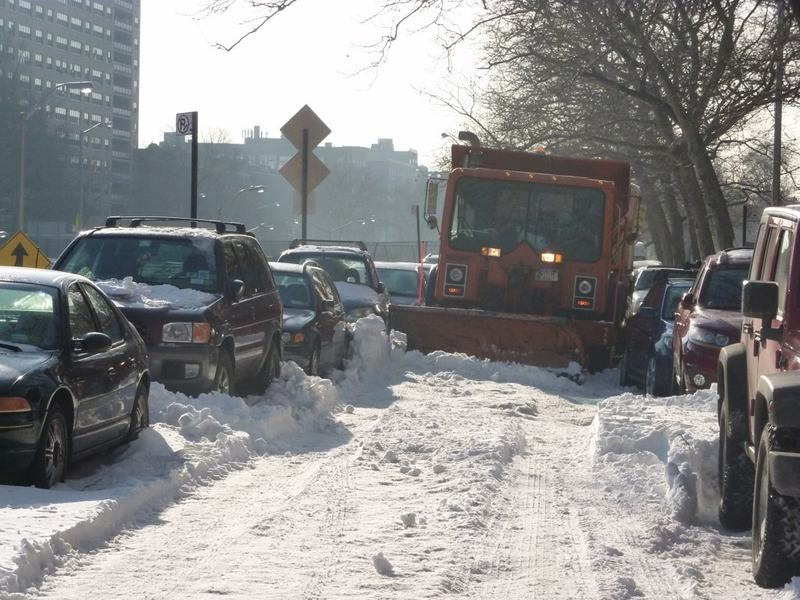 A snow plow in Brooklyn can't get passed parked cars in Brooklyn, days after the city's bungled response to the Christmas-week blizzard.
