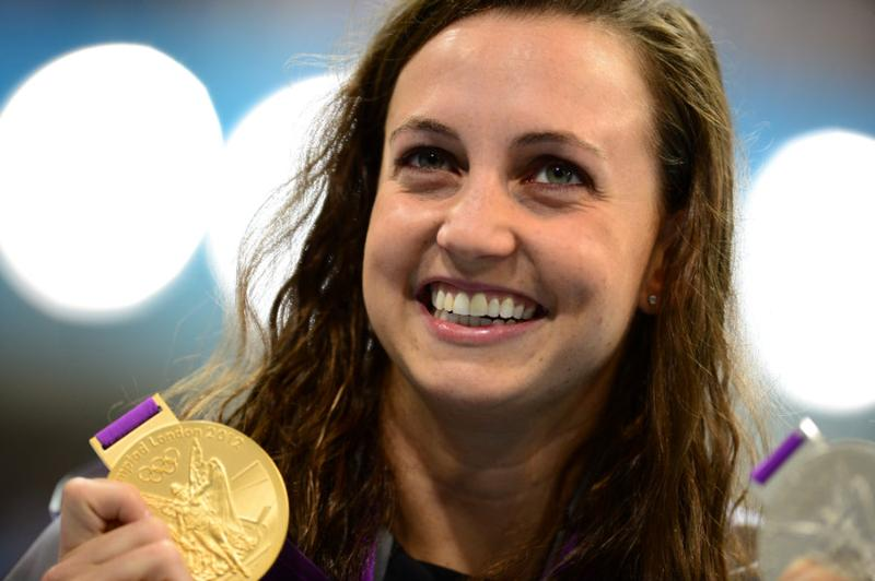 US swimmer Rebecca Soni shows off her gold medal after the podium ceremony.