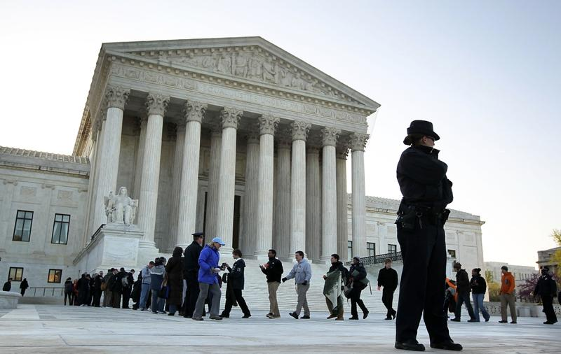 General public with tickets to listen to a hearing on the Obamacare at the U.S. Supreme Court.