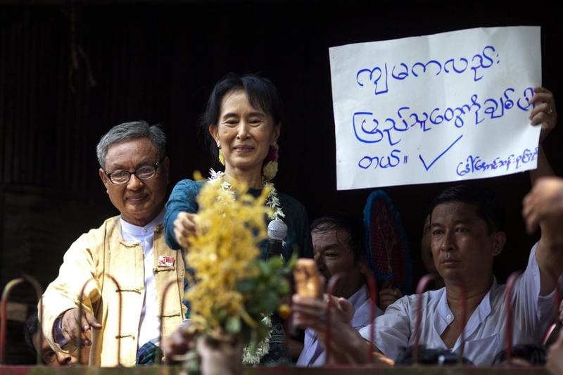 Aung San Suu Kyi addresses thousands of her supporters at her National League for Democracy headquarters on November 14, 2010 in Yangon, Burma