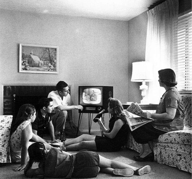 Family watching television in 1958.