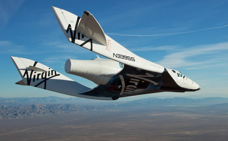 "The Virgin Galactic SpaceShip2 (VSS Enterprise)  glides toward earth on its first test flight after release from the mothership, ""WhiteKnight2"" over the Mojave, Ca. area early Sunday October 10, 2010"