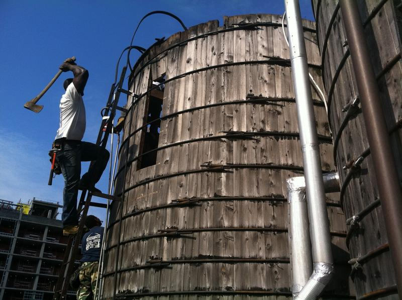 Working on one of the city's many watertanks.