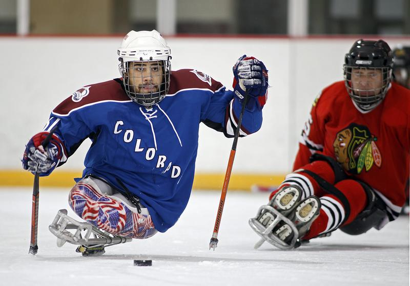 Nikko Landeros of the Colorado Avalanche sled hockey team chases a loose puck during the semifinals of the USA Hockey Sled Classic.