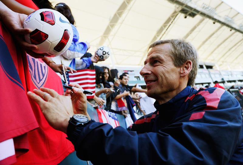 Jurgen Klinsmann coach of US Men's National Team signs soccer balls and soccer jersey after training at The Home Depot Center on August 31, 2011 in Carson, California.