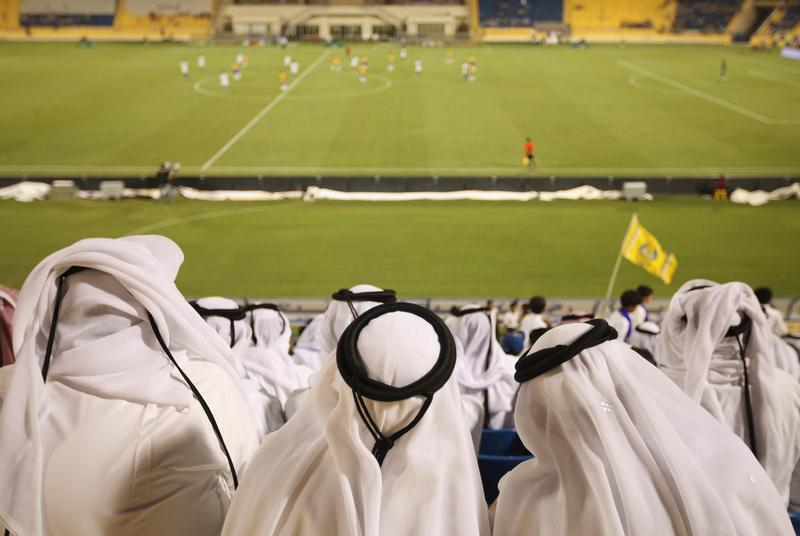 Fans wearing traditional local dress attend the Gharafa vs. Kharaitiyat Qatar Stars League football match at Al Gharafa Stadium on October 23, 2011 in Doha, Qatar.