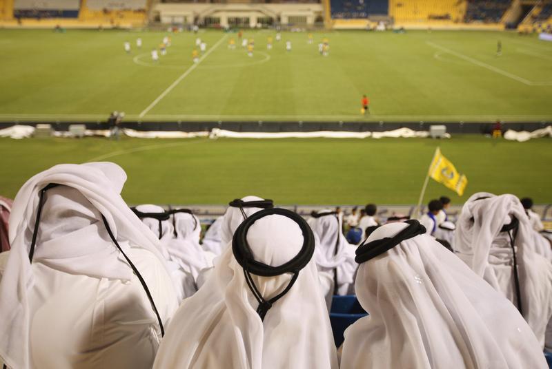 Fans wearing traditional local dress attend the Gharafa vs. Kharaitiyat Qatar Stars League football match at Al Gharafa Stadium on October 23, 2011 in Doha, Qatar.