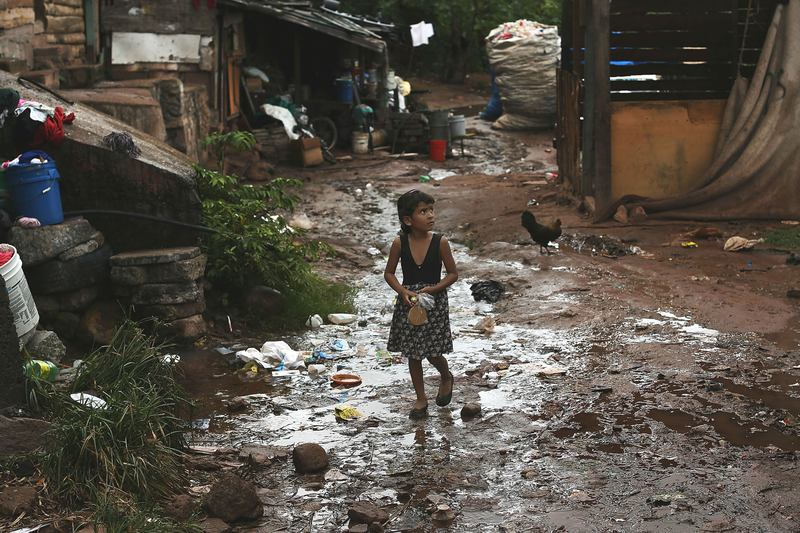 A young child walks home in an area known for heavy drug dealing on July 18, 2012 in Tegucigalpa, Honduras. Honduras now has the highest per capita murder rate in the world.