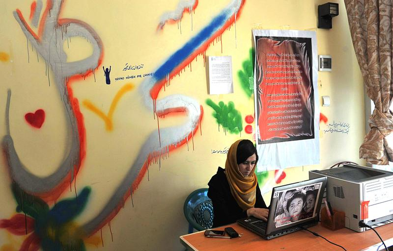 Tooba Ahmadyar ,17, uses her computer at the Young Women For Change internet cafe, Afghanistan's first women-only net cafe, in Kabul. July 22, 2012