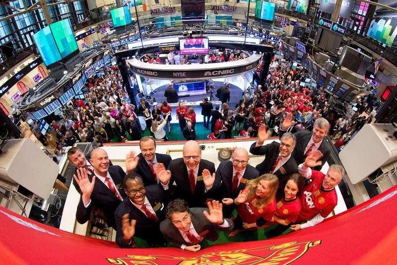 Manchester United Executives David Gill (R), Joel Glazer (C, R) and Avram Glazer (C) with Ed Woodward prepare to ring the Opening Bell at the New York Stock Exchange on Aug. 10, 2012.