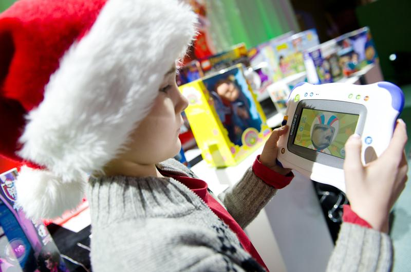 Billy from London plays with the 'Innotab 2' from V-Tech at the 2012 'Dream Toys' exhibition in central London on October 31, 2012.