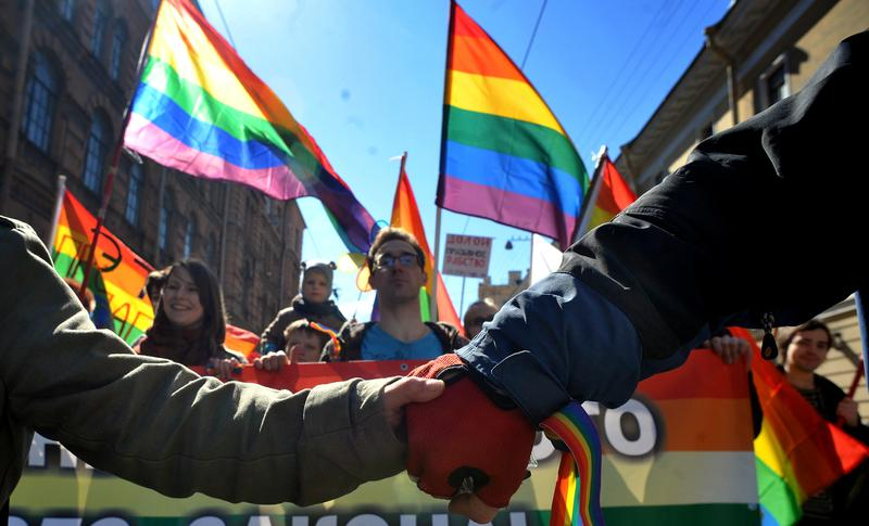 Gay rights activists march in Russia's second city of St. Petersburg May 1, 2013, during their rally against a controversial law in the city that activists see as violating the rights of gays.