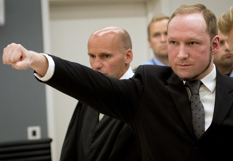 August 24, 2012 Self confessed mass murderer Anders Behring Breivik raising his fist in a right wing salute after being sentenced to 21 years in prison, in court room 250 at Oslo District Court.