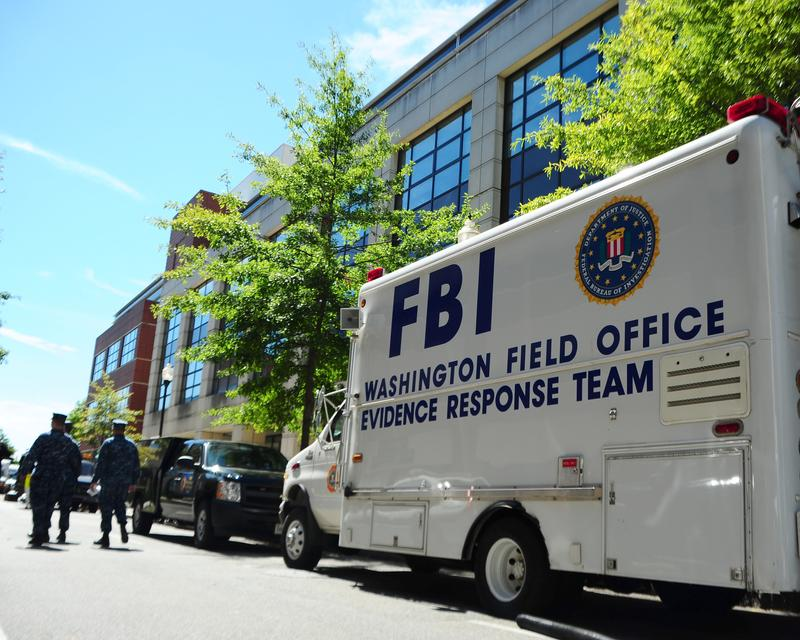 In this handout image provided by the U.S. Navy, An F.B.I. evidence response team collects evidence on September 18, 2013 at Building 197 at the Washington Navy Yard in Washington, DC.