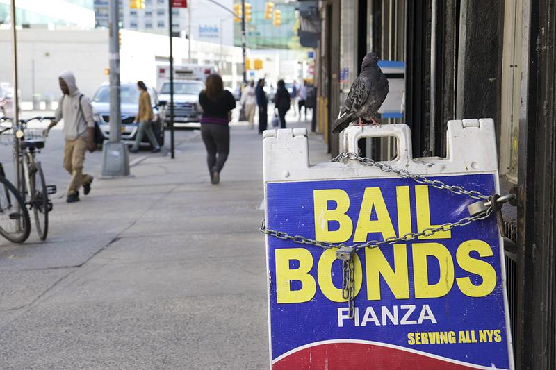 Offices advertising bail bonds across the street from the Bronx Family Court.
