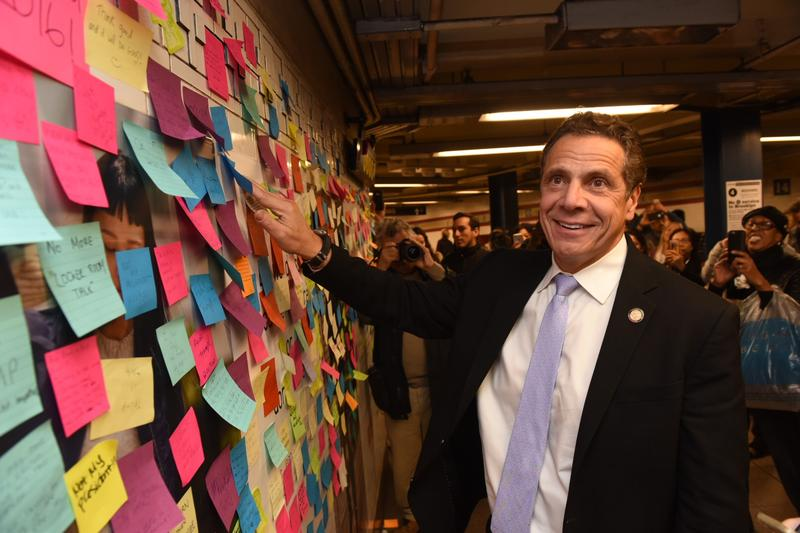 NY Governor Andrew Cuomo posting a note in the Union Square subway station
