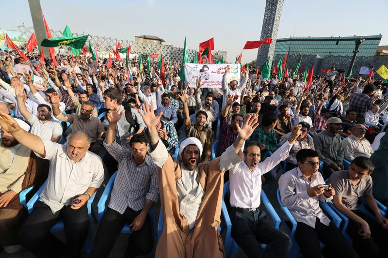Iranians shout slogans during a protest against the Sunni Arab militants offensive led by the jihadist Islamic State of Iraq and the Levant (ISIL) in Iraq on June 24, 2014 in Tehran.