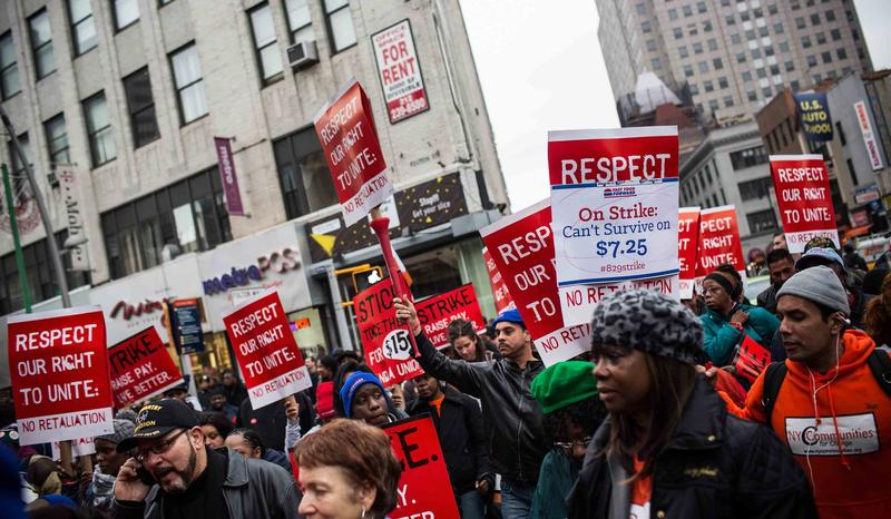 Protesters rally outside of a Wendy's in support of raising fast food wages from $7.25 per hour to $15.00 per hour on December 5, 2013 in the Brooklyn borough of New York City.