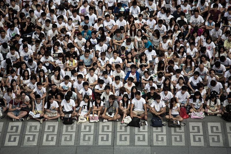 Thousands of students from more than 20 tertiary institutions start a week-long boycott of classes in protest against Beijing's conservative framework for political reform in Hong Kong.